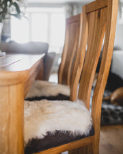 Nordvek Icelandic sheepskin chair cover 9020-100 group on wooden floor