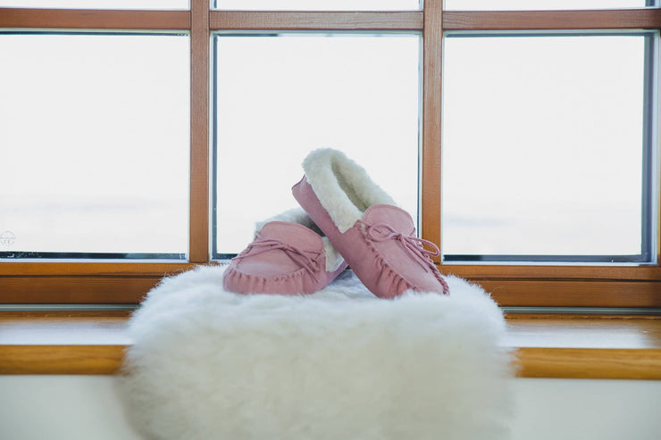 Nordvek womens moccasins hard sole  418-100 pink pair on sheepskin rug in window
