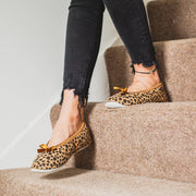 shepherd womens sheepskin slippers SAGA leopard model wearing slippers walking downstairs