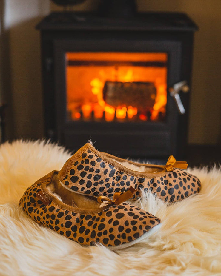 shepherd womens sheepskin slippers SAGA leopard pair in front of fire