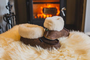 Shepherd womens sheepskin slippers MOA oiled antique pair in front of fire
