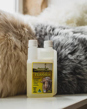 Tantech woolwash in front of sheepskin cushions