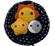 Calming toys for anxiety - crocheted amigurumi sun, moon and star against a black crocheted play mat and carry case