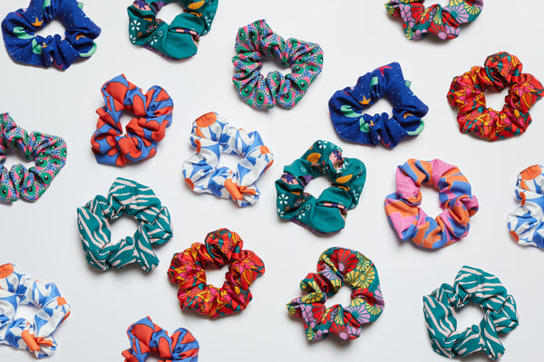 flat lay of colourful and vibrant hair scrunchies
