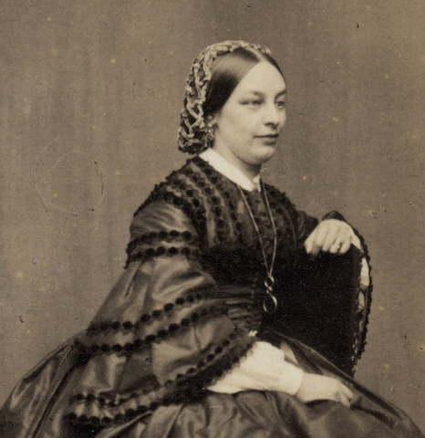 black and white photo of woman in 19th century wearing a knitted snood