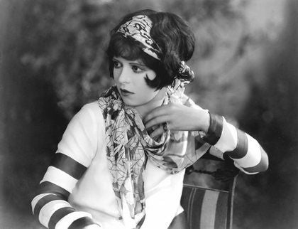 Actress Clara Bow in black and white photo with silky scarf striped sleeves and large headband