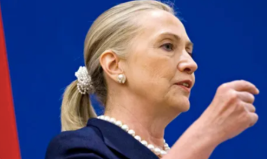 Hillary Clinton wearing a pearl beaded scrunchie while giving a speech
