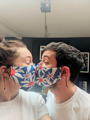 Looking cute in Newt, this pair are stylishly wearing our ethically made daisy masks.