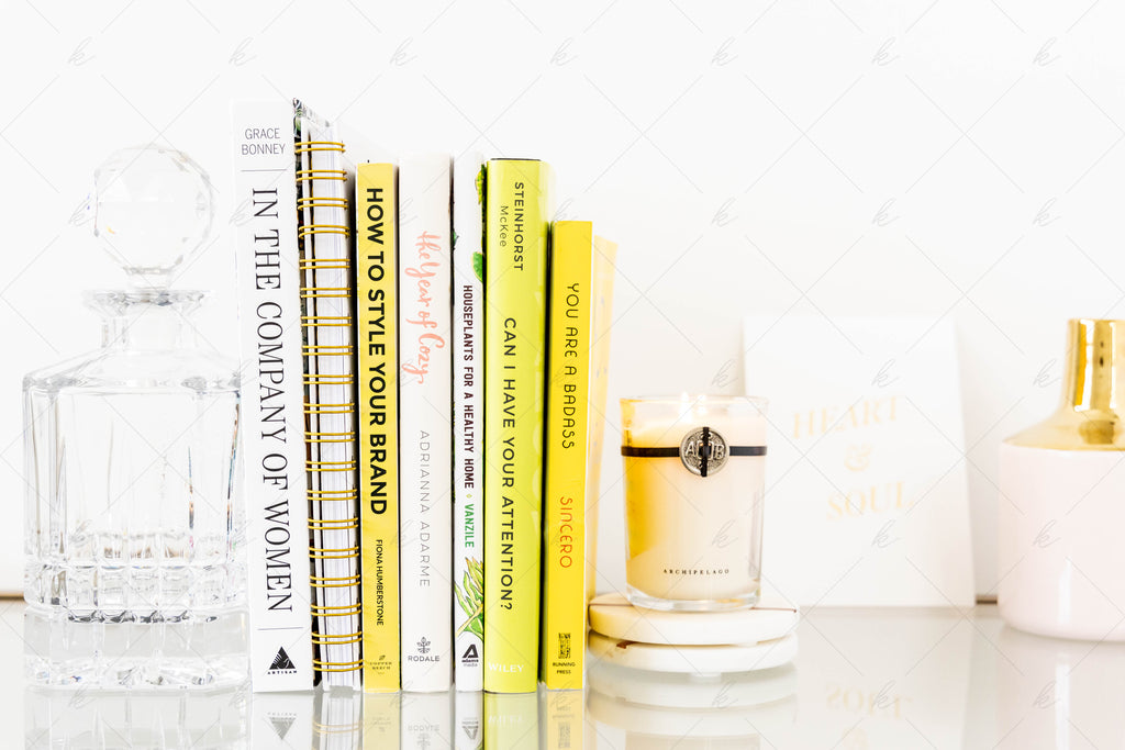 Office styled stock photo with books and a candle