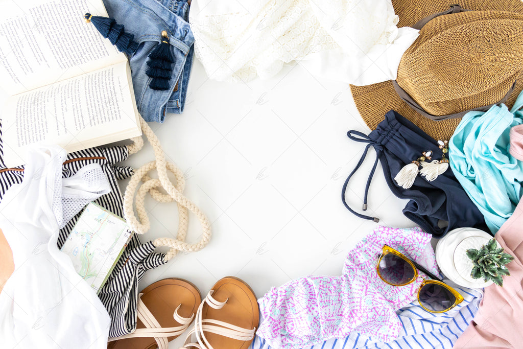 various summer items in stock photo with negative space in the center