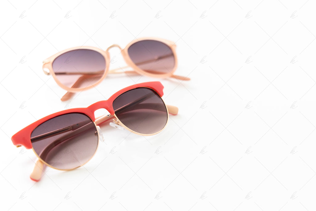 Pair of pink sunglasses and blush sunglasses