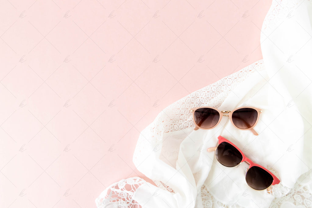 Pair of pink sunglasses and blush sunglasses on a blush background