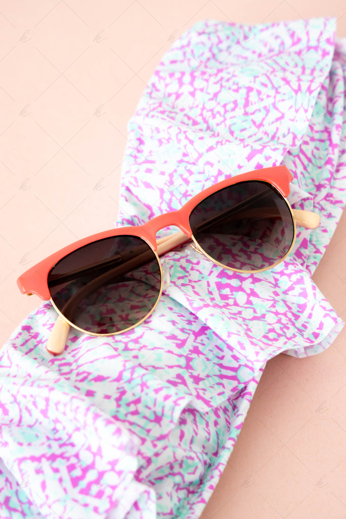 pink sunglasses, pink and teal bathing suit on a pink background summer stock photo