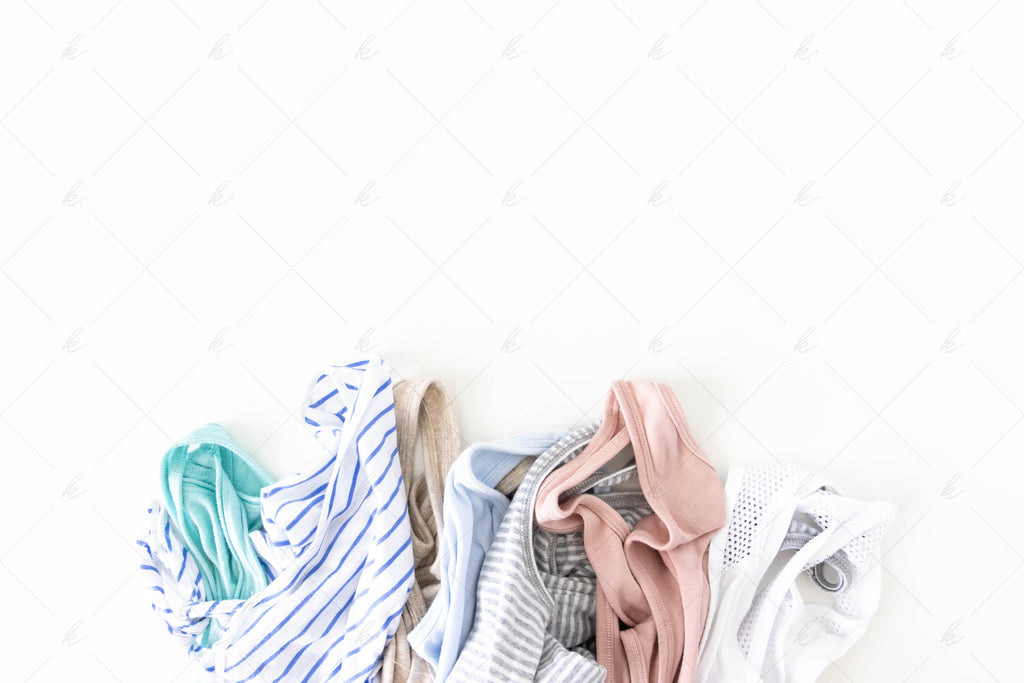 various tank tops, teal, blue, pink, grey, white summer stock photo