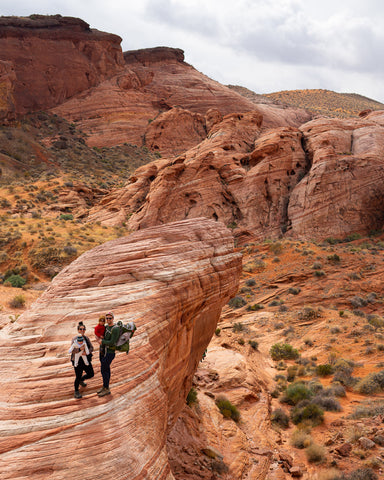 Family hiking through Valley of Fire