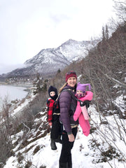 Brenda hiking with 2 kids in carriers