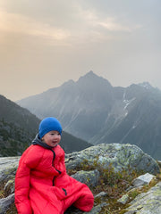 Baby in Sleeping Bag in Mountains