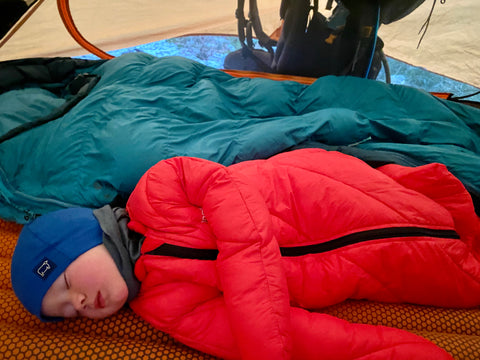 Baby sleeping in the tent