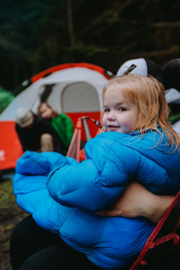 Toddler in Big Mo 40° Kids Sleeping Bag (Ages 2-4) Sitting in Chair Outside Camping Warm and Happy - Morrison Outdoors