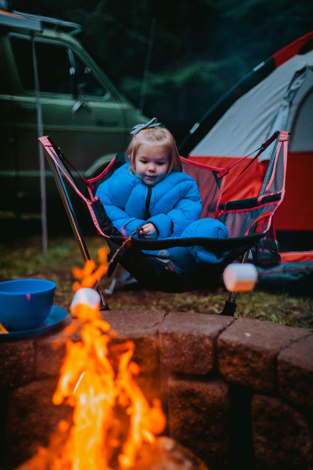 Toddler in Big Mo 40° Kids Sleeping Bag (Ages 2-4) Sitting around a Fire Camping Warm and Happy - Morrison Outdoors