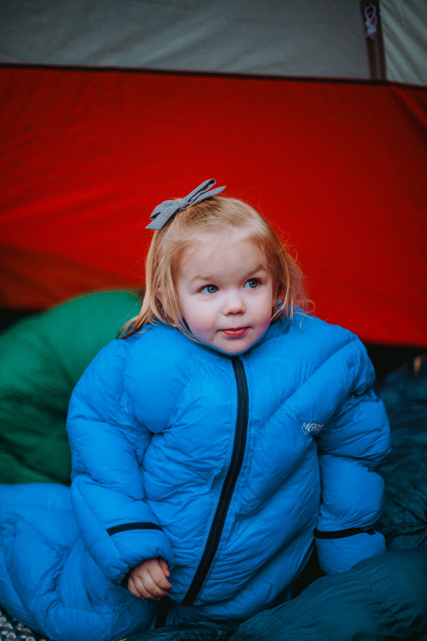 Toddler in Big Mo 40° Kids Sleeping Bag (Ages 2-4) Sitting in Tent Outside Camping Warm and Happy - Morrison Outdoors