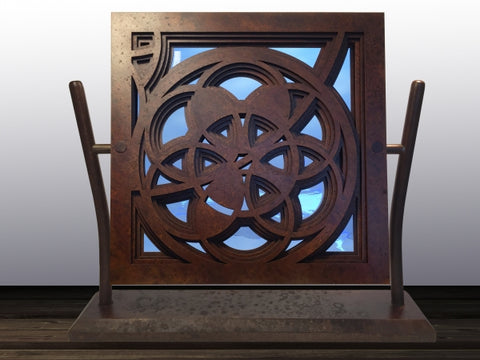 Rose Window in Rust & Blue - Steel & Glass Sculpture by artist William Freer