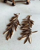 Gold tiered leaf earrings