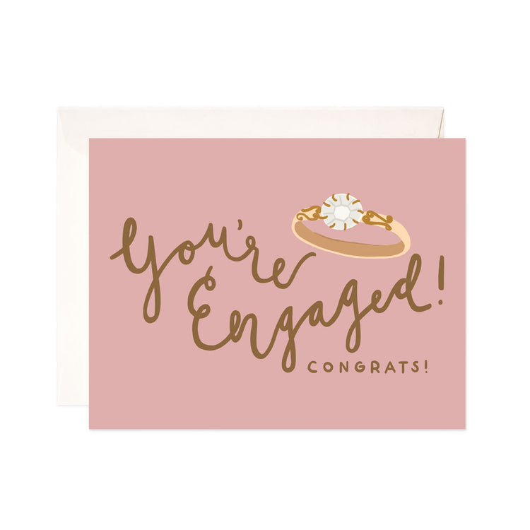Engaged Ring - Bloomwolf Studio Card That Says You're Engaged! Congrats!, Pink Background, Gold Print, Diamond Ring