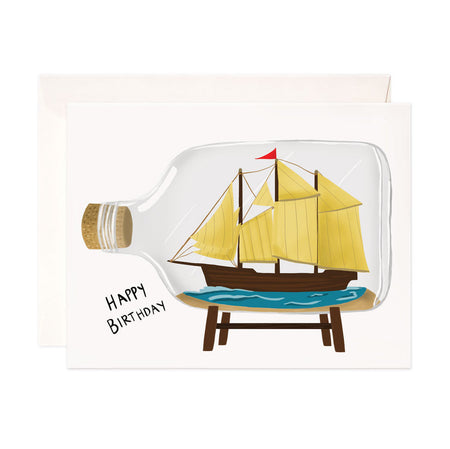 Ship in a Bottle Birthday - Bloomwolf Studio Birthday Card, Blue Seas, Yellow Sailboat Inside a Bottle
