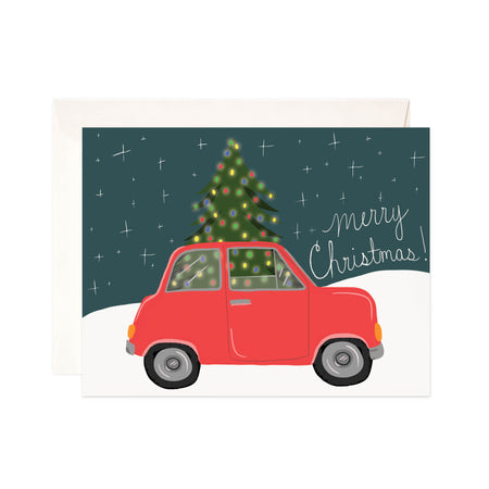 Tree Transport - Bloomwolf Studio Card That Says Merry Christmas + Holiday, Red Car, Christmas + Holiday Tree, Colorful Lights, Snow