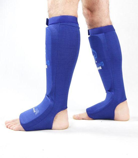 Side view of a Ground Game Knockout Game Elastic Shin Guards Blue