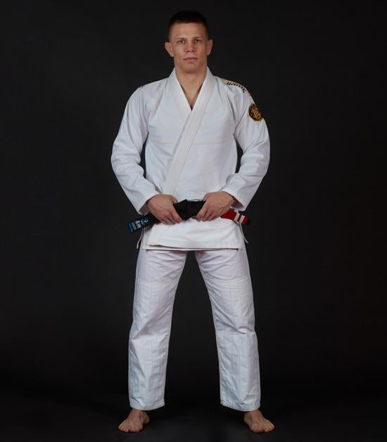 Front view of a Ground Game Champion 2.0 BJJ Gi White