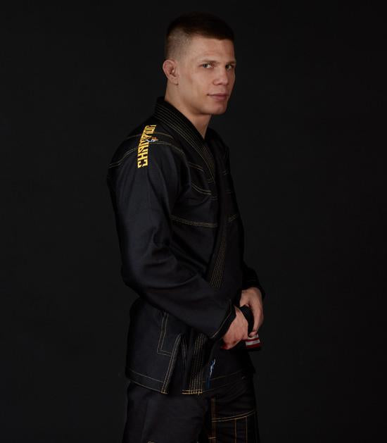 Side view of a Ground Game Champion 2.0 BJJ Gi Black