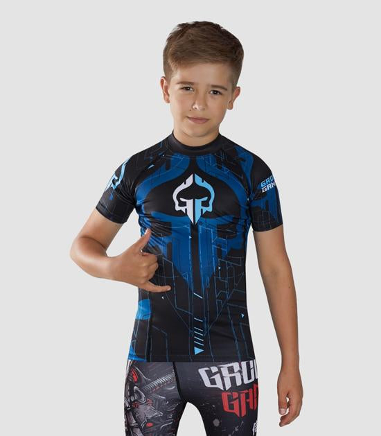 Front view of a Ground Game Shapes Kids Rashguard Blue