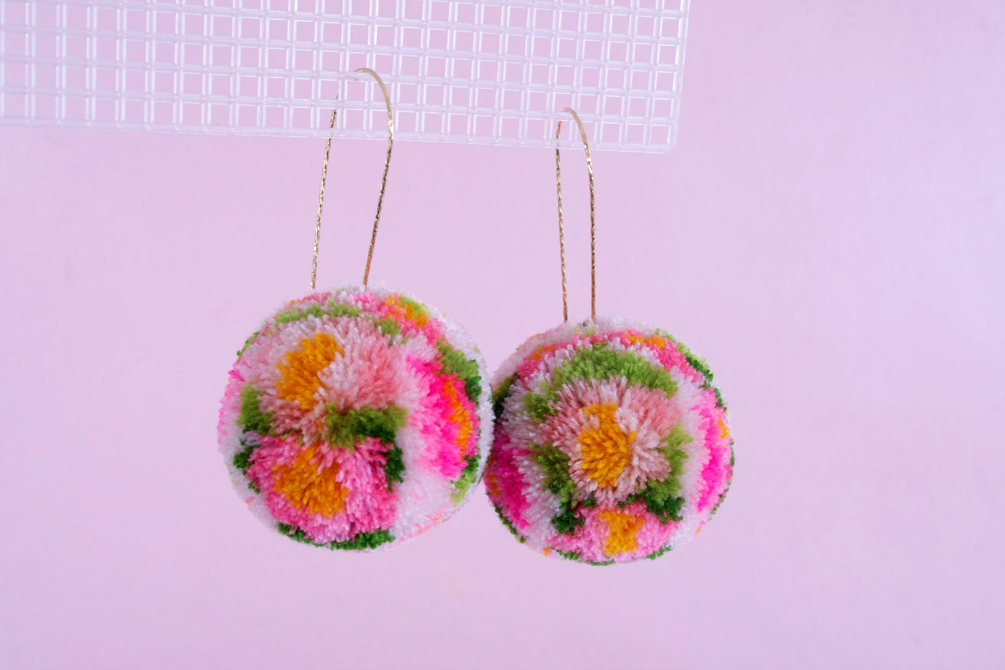 pink floral pom pom earrings
