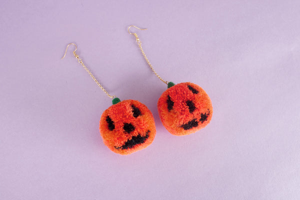 jack o lantern pumpkin pom pom earrings