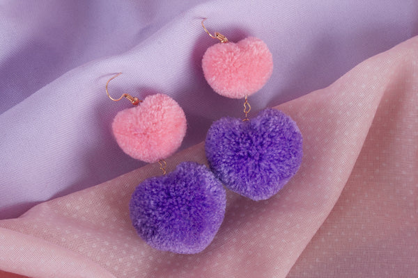 duo heart pom pom earrings