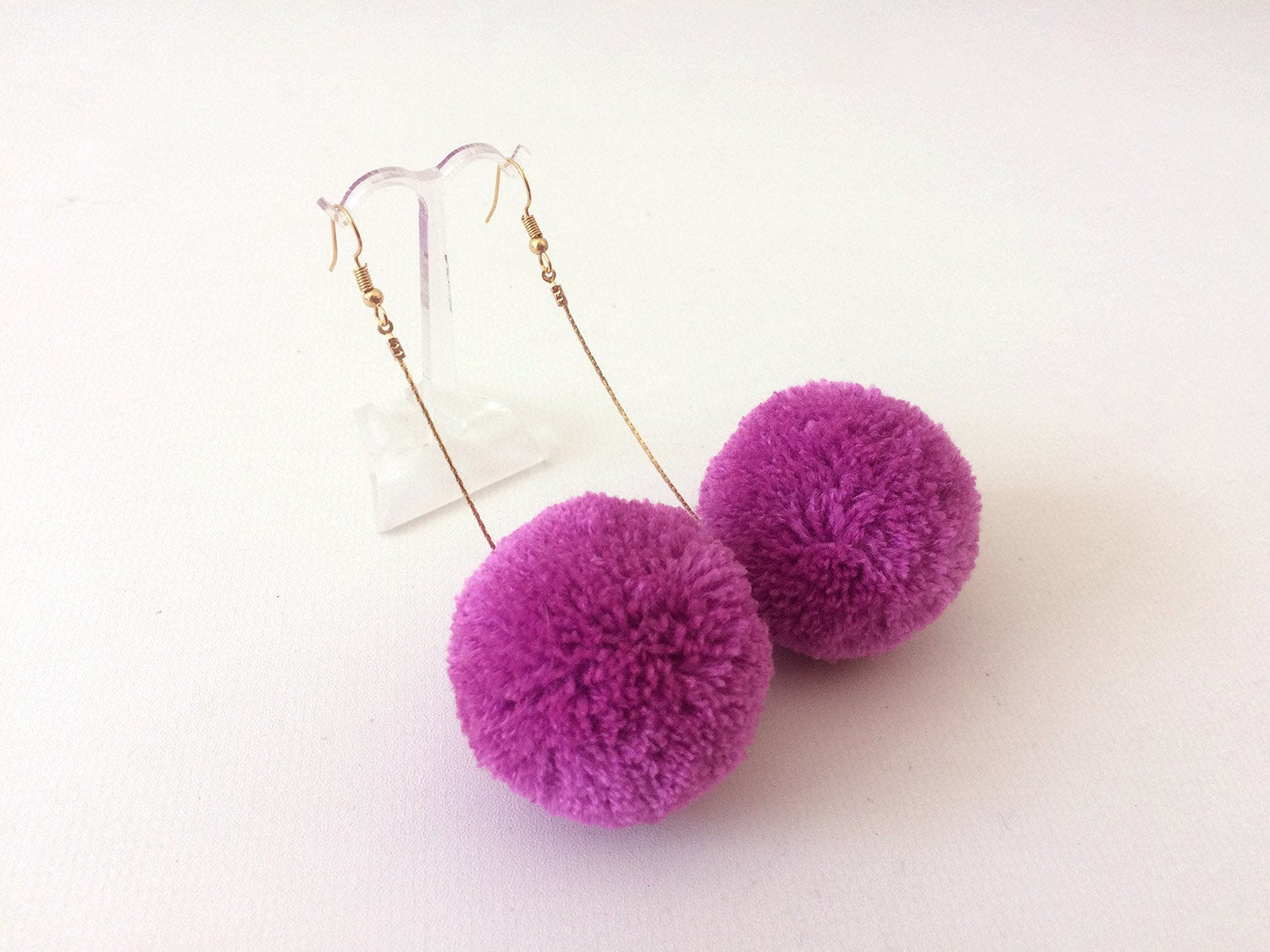 lilac dangly pom pom earrings