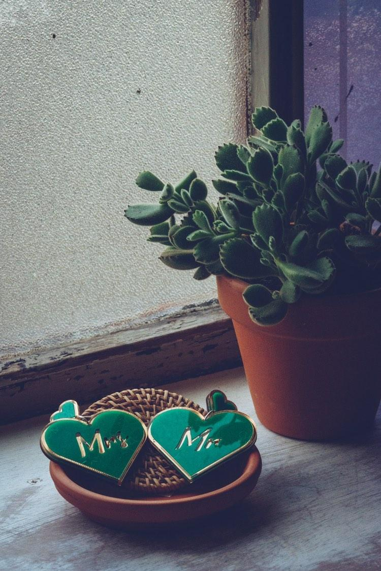 Laser cut heart earrings with custom slogan