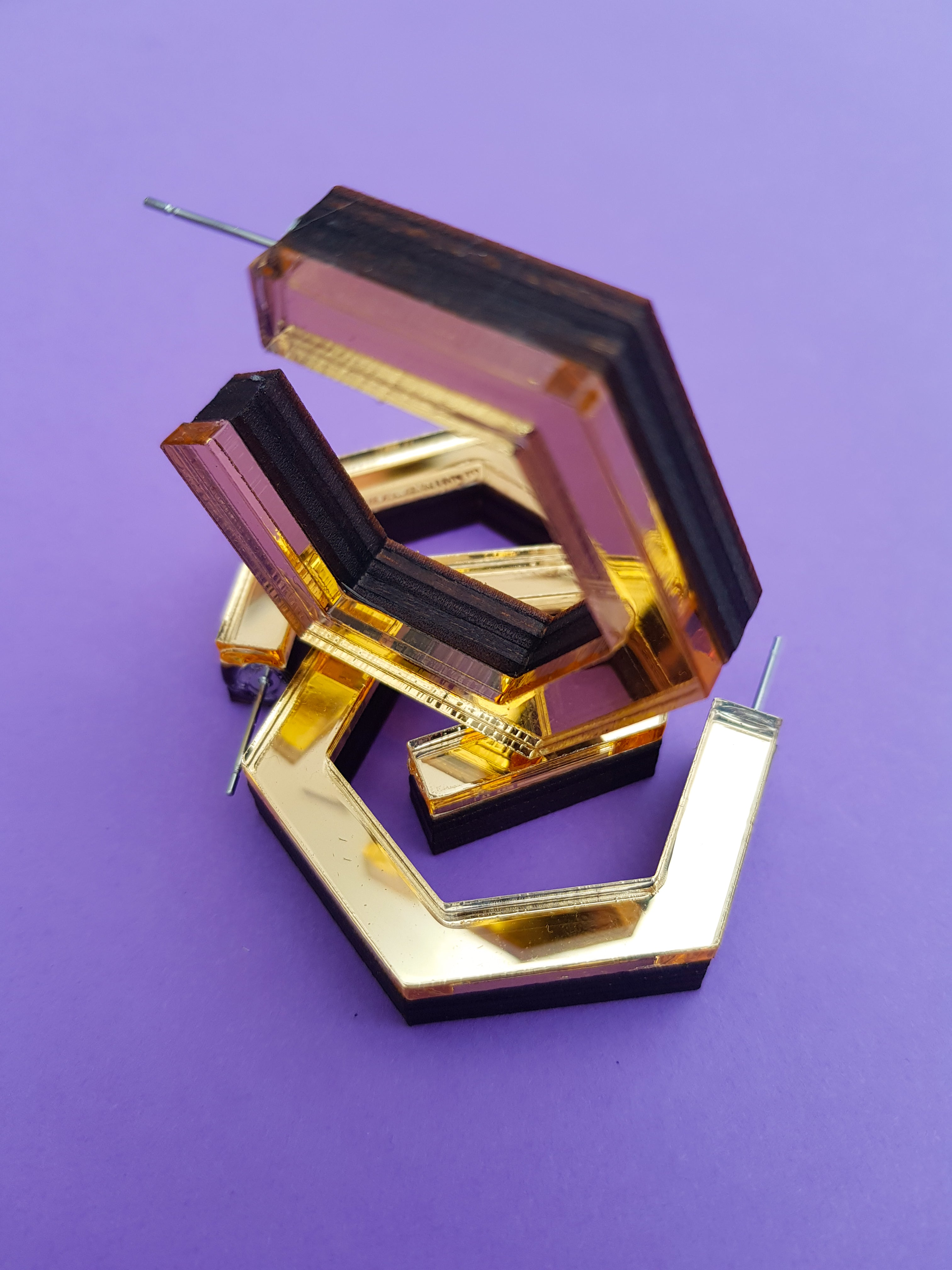 Gold hexagonal ply and perspex hoop earrings