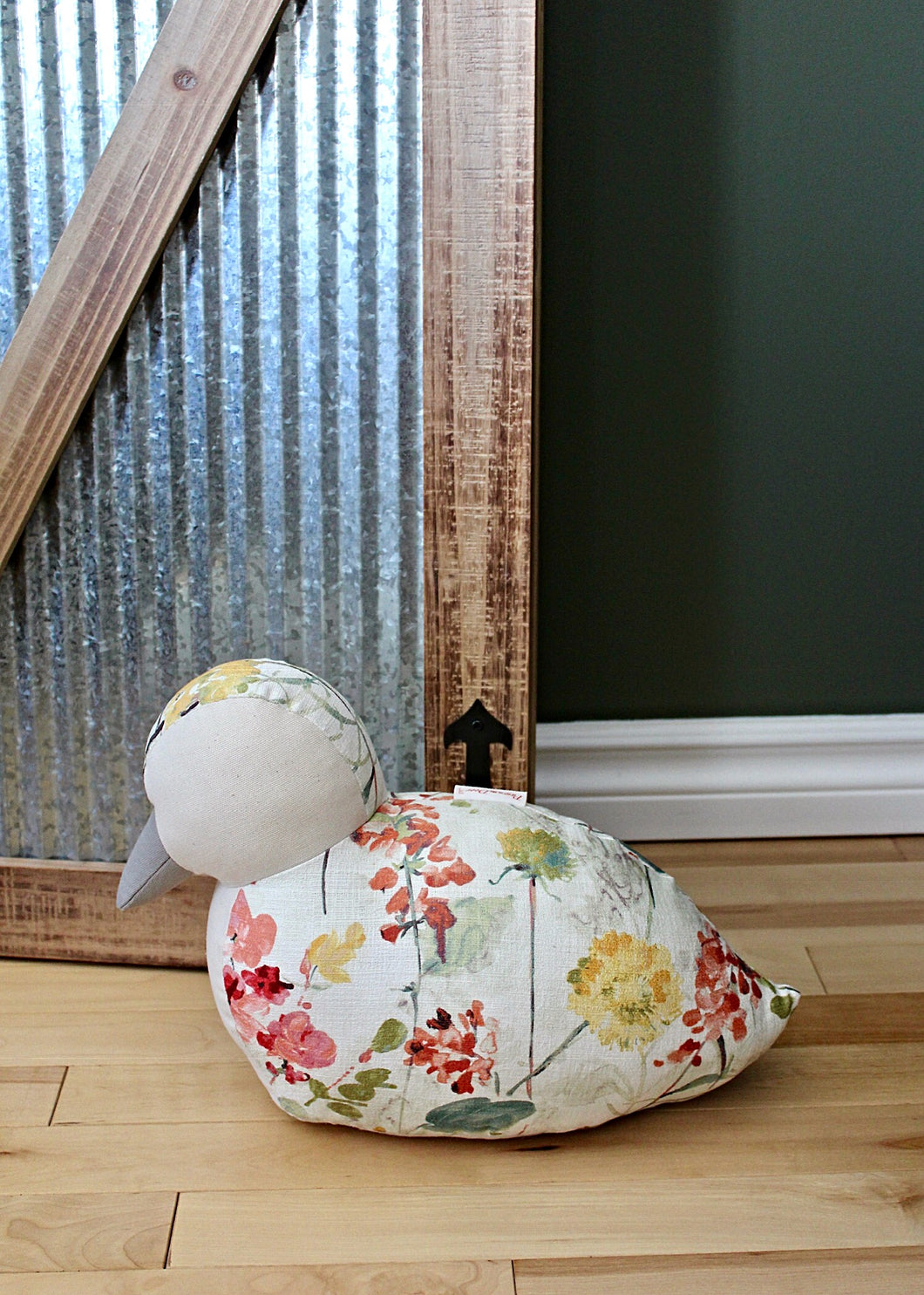 This handmade duck doorstop from Paw in the Door's Country Farm Doorstop Collection provides a charming and practical addition to any home's decor