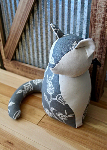 This handmade cat doorstop from Paw in the Door's Country Farm Doorstop Collection provides a charming and practical addition to any home's decor