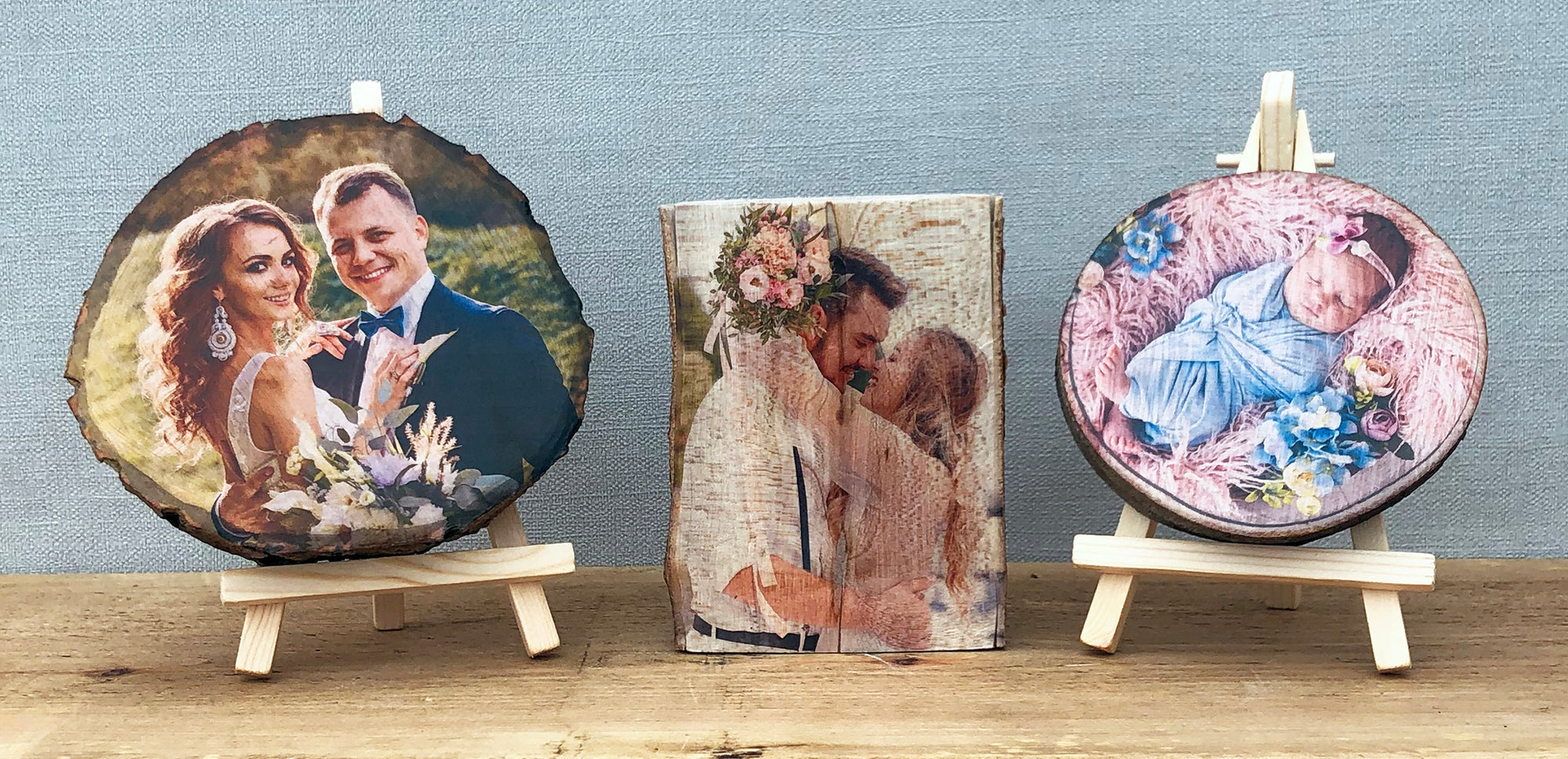 A wood slice plaque showing a bride and groom on their wedding day, a freestanding log plaque showing a bride and groom on their wedding day and a mini wood slice plaque showing a newborn baby