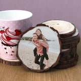 Wood Slice coaster showing a couple on the beach