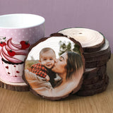 Wood Slice coaster showing a woman holding a baby