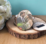 wood slice fridge magnet shown on a large wood slice and a bouquet of flowers. Image shows a married couple.