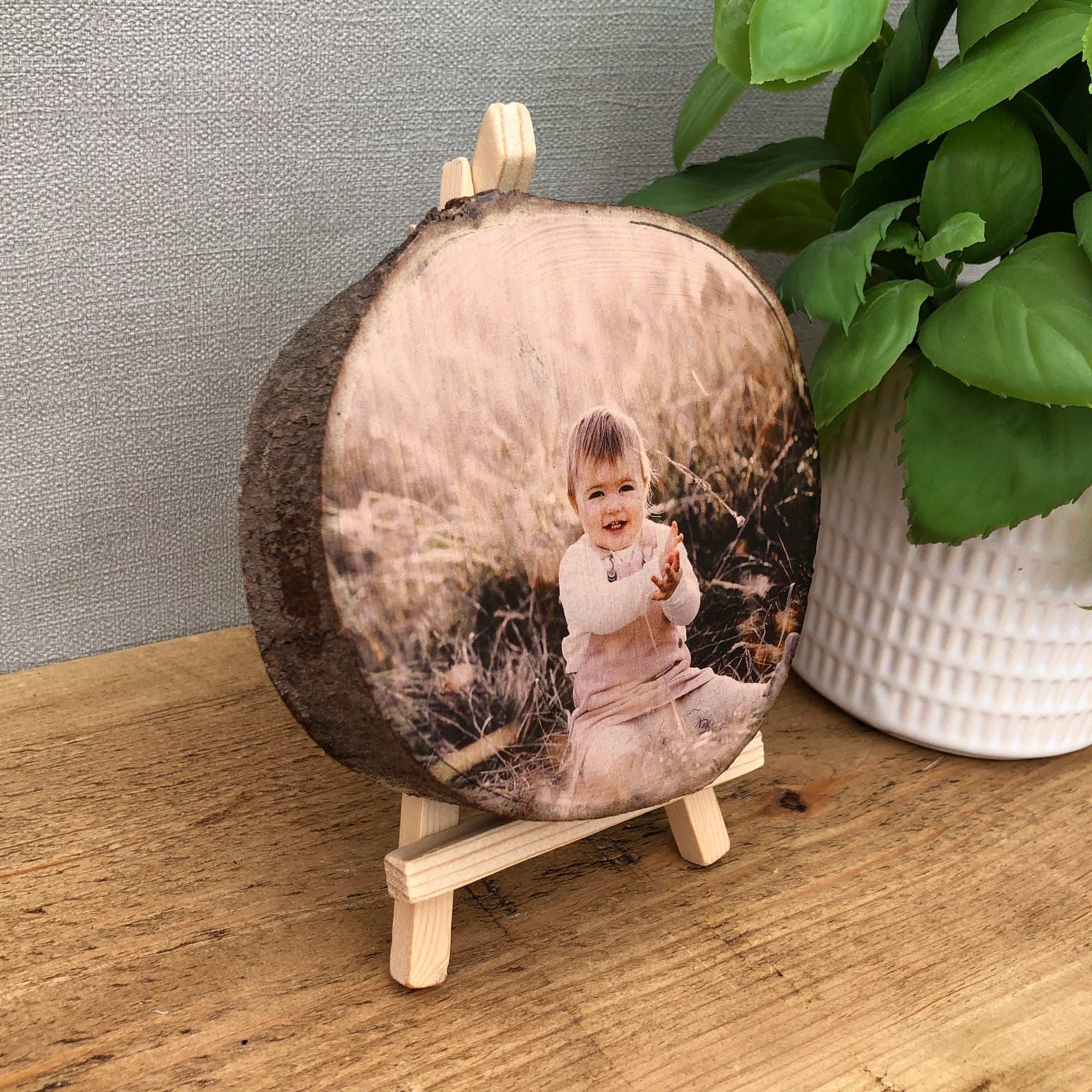 wood slice photo plaque showing a baby