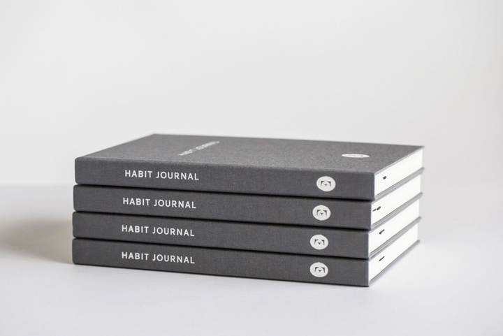 Stack of Dark Grey Hardcover Evergreen Journals Habit Journals