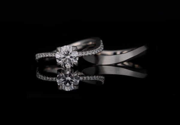Bespoke diamond engagement ring with fitted wedding band