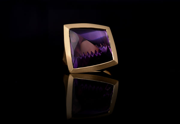 16ct Fancy cut Amethyst cocktail ring set in 18ct gold.